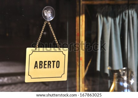 "Sign ""Open"" in old cafe in Lisbon, Portugal - stock photo"