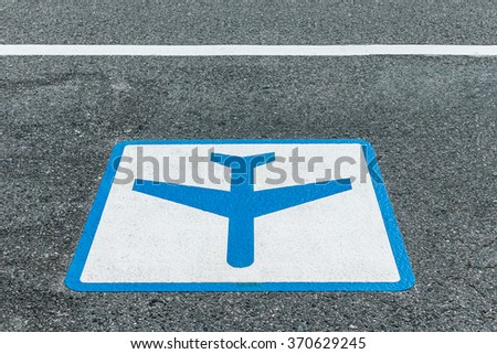 sign painted on asphalt road for airport shuttle bus - stock photo