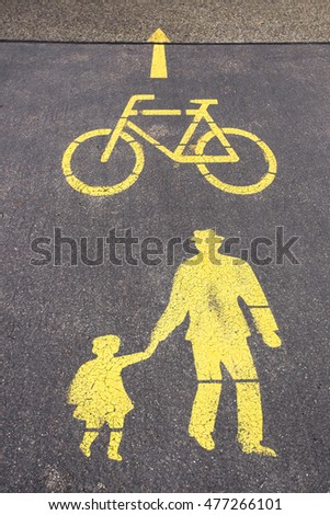 Sign pedestrian crossing and bicycle way on asphalt