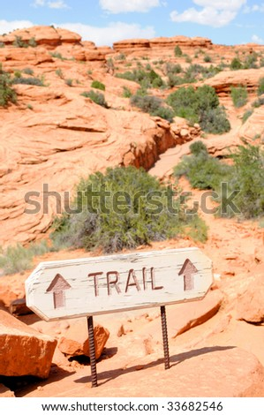 "Sign pointing to the trail on the way to the famous ""Delicate Arch"" in the Arches National Park near Moab, Utah, USA. - stock photo"