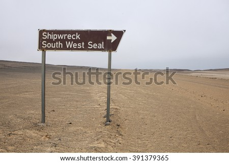 Sign post for ship wreck on Namibia's Skeleton Coast - stock photo