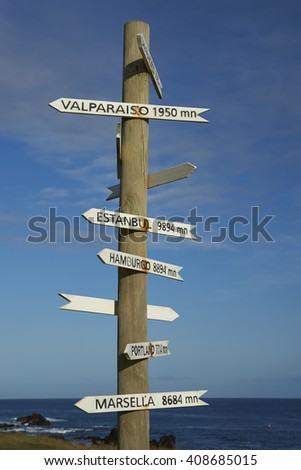 Sign post on the coast of Easter Island showing the distance to various cities around the world. - stock photo