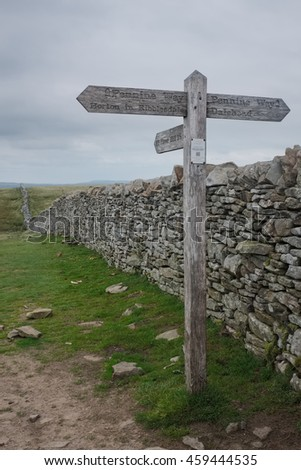 Sign post on top of Pen-y-ghent, one of the three peaks in North Yorkshire