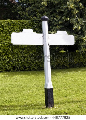 Sign post;  traditional British roadside direction sign; blank for your own text; fingerpost  - stock photo
