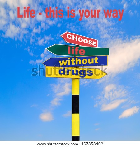 Sign post with four arrows of diffirent colors and directions and text - Choose life without drugs, and lettering - Life - This Is Your Way on a blue sky background. Social advertising Motivation  - stock photo
