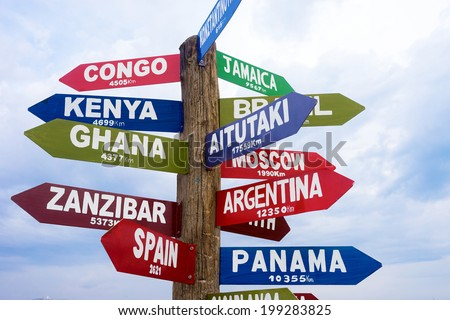 Sign post with multiple international directions. - stock photo