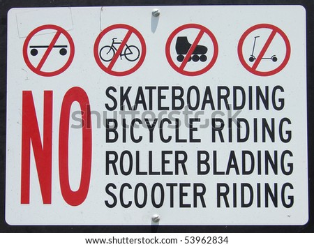 sign prohibiting bicycles scooter roller blades and skateboards - stock photo