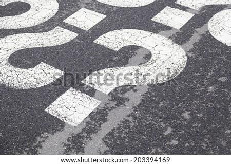 Sign question on asphalt, detailed interrogation signal, information - stock photo