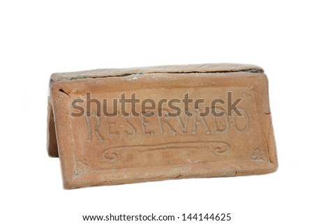 Sign saying Reservado or Reserved - stock photo