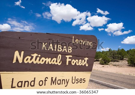 Sign telling people they are leaving the Kaibab National Forest, Arizona, USA. - stock photo
