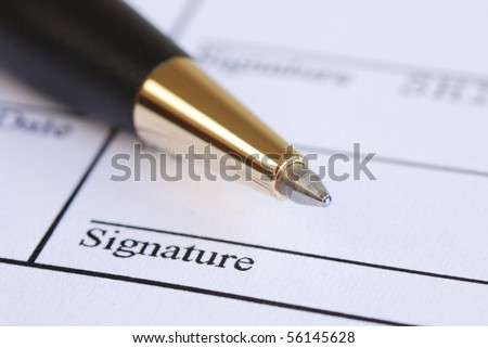 Sign the name on a paper with a pen - stock photo