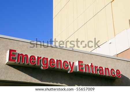"""Sign: The word """"Emergency Entrance"""" on hospital building - stock photo"""