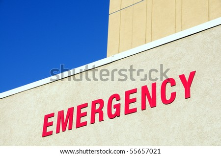 """Sign: The word """"Emergency"""" on hospital building - stock photo"""