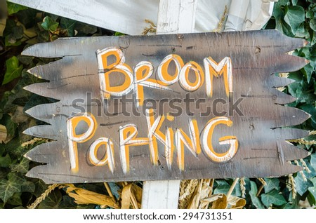 Sign to let witches know where to park their brooms.  Great for Halloween! - stock photo