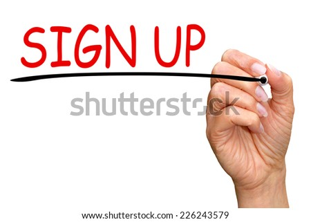 Sign up - female hand with pen on white background - stock photo