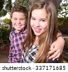 Sign up portrait of a boy and a girl in the sun - stock photo