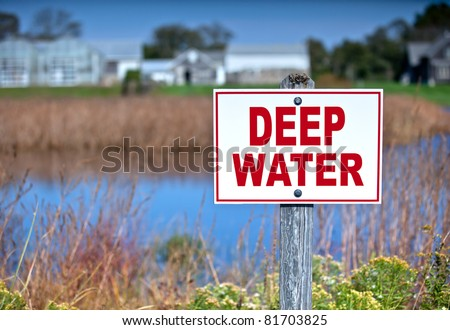 Sign warning of deep water. - stock photo