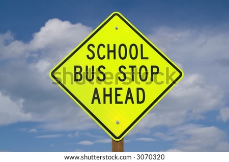 Sign warning of school bus stop ahead often found on rural roads - stock photo