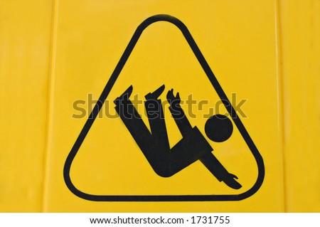 Sign warning of slippery floor - stock photo