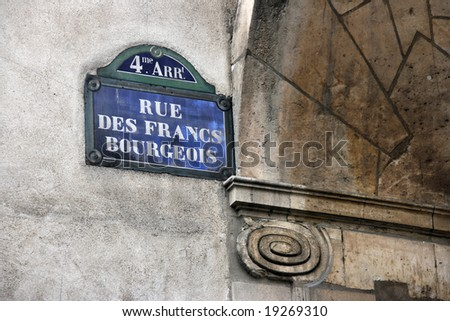 Sign with a street name in Paris, France: Rue des Francs Bourgeois. 4me arrondisement (4th district). - stock photo