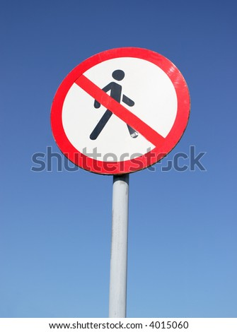 sign with crossed pedestrian on blue sky - stock photo