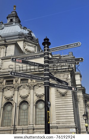 Sign with directions to London's landmarks - stock photo