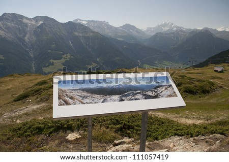 Sign with map of mountain peaks - stock photo