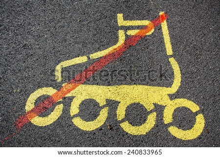 Sign with restriction of inline skating painted on a tarmac road - stock photo