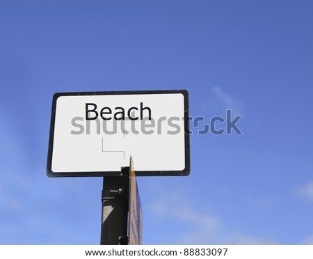 Sign with text beach and right directed arrow in Great Britain