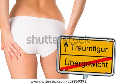 Sign with the german words dream figure and overweight and a buttock from a woman / dream figure - stock photo