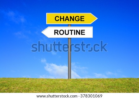 Sign with two arrows shows change or routine - stock photo