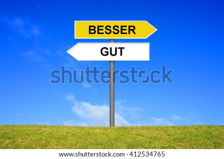 Sign with two arrows shows Good or Better in german language - stock photo
