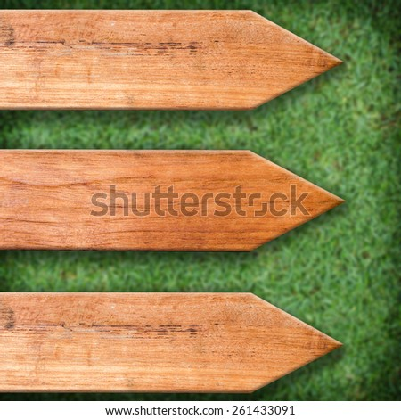 sign wooden board on grass - stock photo