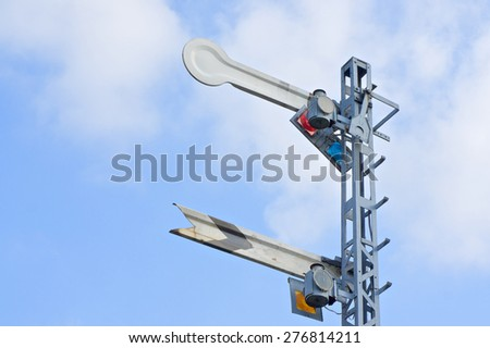 Signal caution pole of train with cloud and blue sky as background. - stock photo