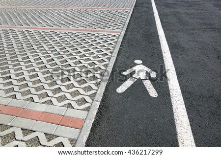 signal pedestrian street in a parking lot - stock photo