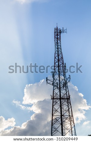 Signal tower on blue sky background - stock photo
