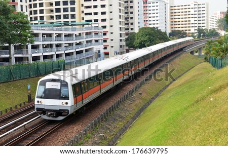 SIGNAPORE - FEBRUARY 10, 2014:Singapore mass rapid train (MRT) travels on the track. The MRT has 106 stations and is the second-oldest metro system in Southeast Asia, after Manila's LRT.  - stock photo
