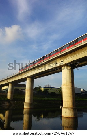 SIGNAPORE - JUN 22, 2014: Singapore mass rapid train (MRT) travels on the track. The MRT has 106 stations and is the second-oldest metro system in Southeast Asia, after Manila's LRT.