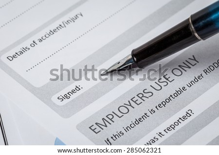Signature field on document with pen and signed here; document is mock-up - stock photo