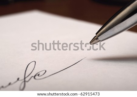 signature (imaginary, partal) and pen it maked by (as sign of success) - stock photo