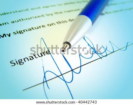 Signature on a business contract - stock photo