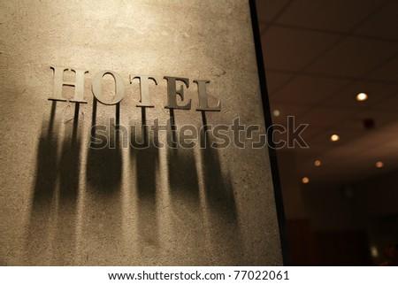 """Signboard """"Hotel"""" on a building facade - stock photo"""