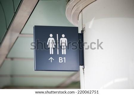 Signboard in subway, Bathroom. - stock photo