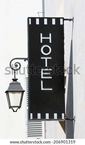 Signboard of the main entrance of the hotel - stock photo