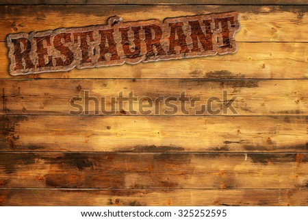 "signboard ""restaurant"" nailed to a wooden wall - stock photo"