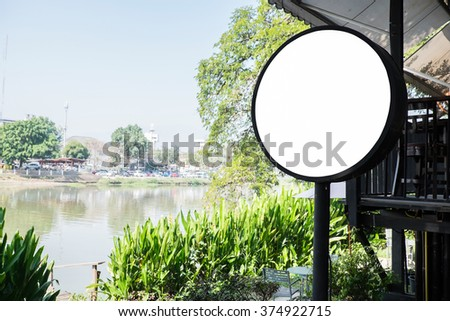 Signboard shop Mock up Circle shape Vintage tone in outdoor. - stock photo