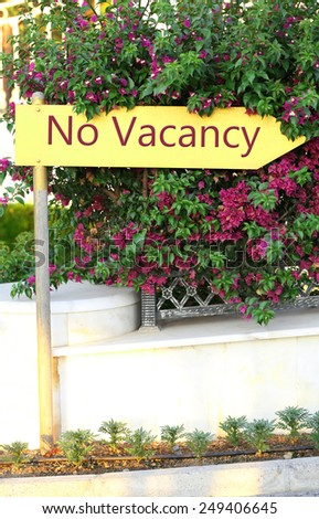 Signboard with text No Vacancy near hotel - stock photo