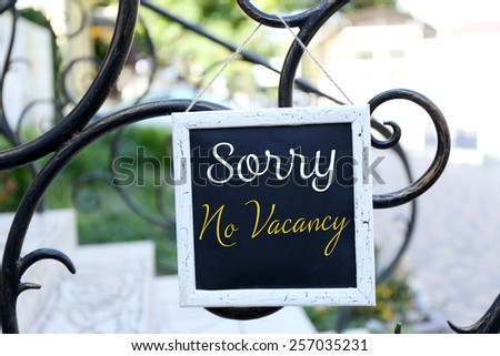 Signboard with text Sorry No Vacancy near hotel - stock photo