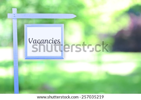 Signboard with text Vacancies near hotel - stock photo