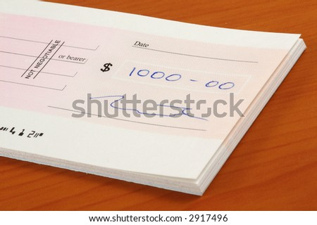 Signed one thousand dollars cheque - stock photo